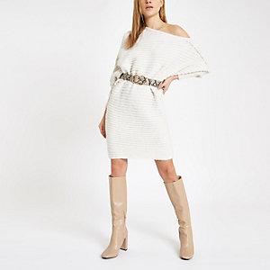 Crème gebreide asymmetrische trui-jurk