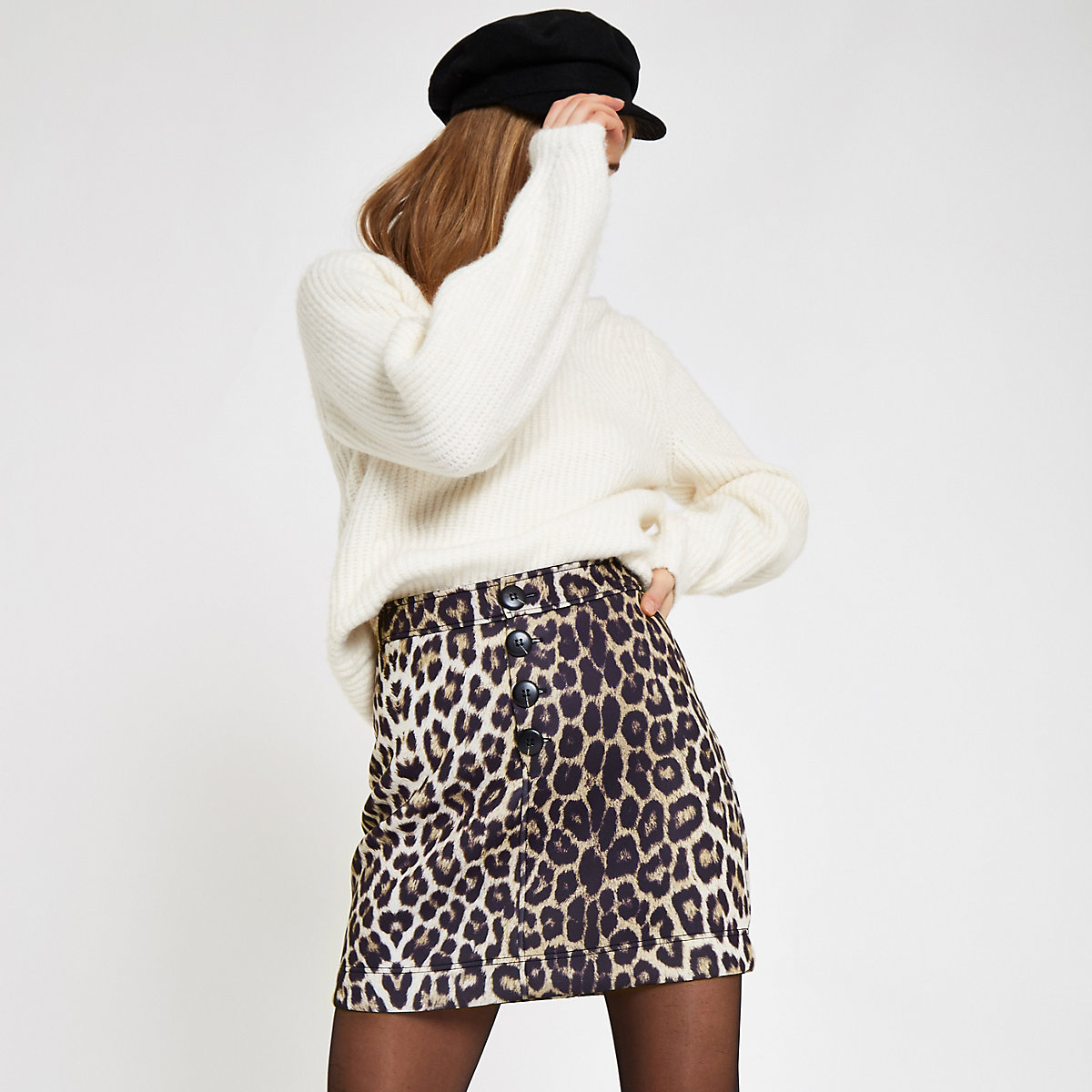 Beige leopard print button front mini skirt