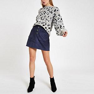 Mini-jupe imitation daim bleu marine boutonnée devant