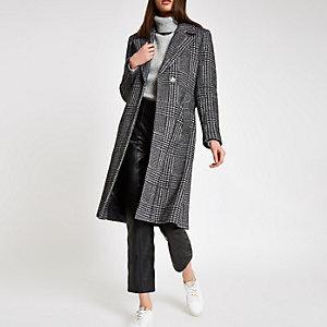 Zwarte gebreide jas met strikceintuur en visgraatruit