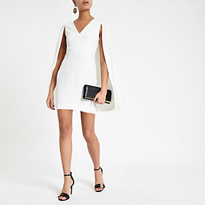 Cream bodycon cape sleeve mini dress