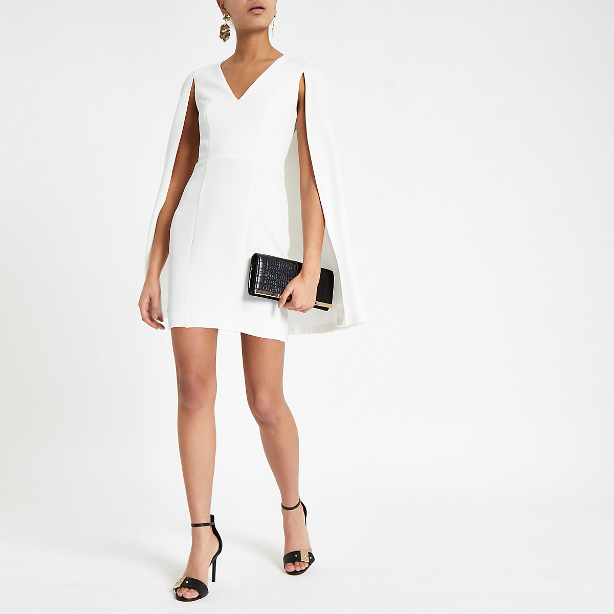 Cream bodycon cape sleeve mini dress