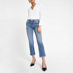 Blauwe cropped uitlopende jeans