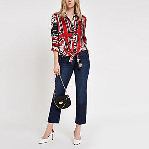 Donkerblauwe cropped uitlopende jeans