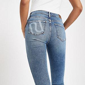 Amelie - Lichtblauwe skinny jeans met RI-logo