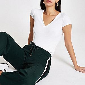 T-shirt ajusté côtelé blanc à col en V