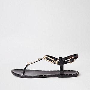 Black studded jelly sandals