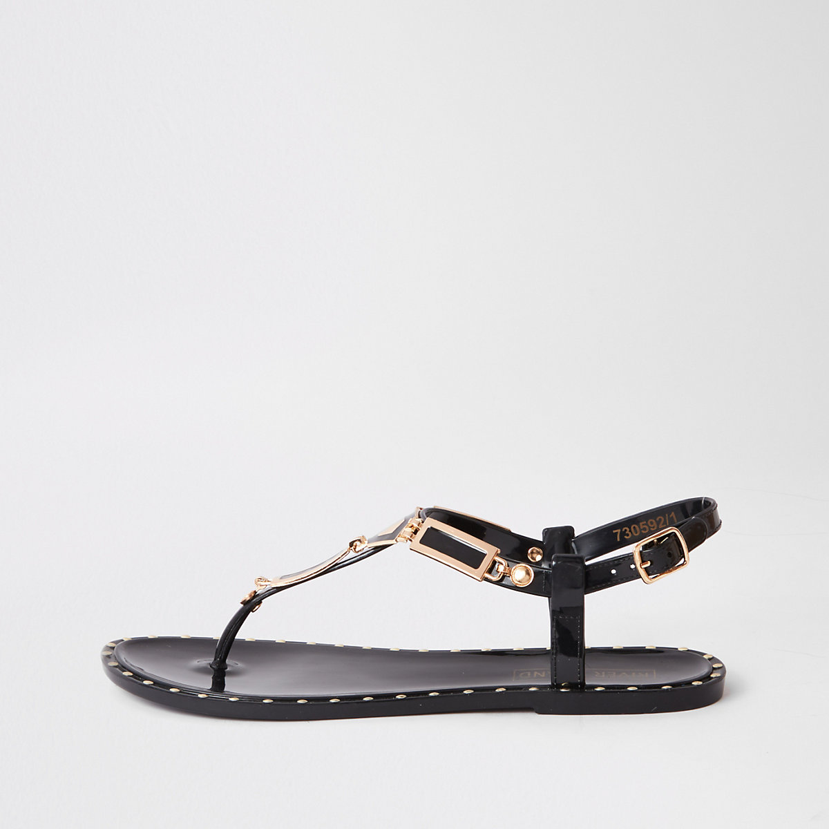 Black studded jelly sandals