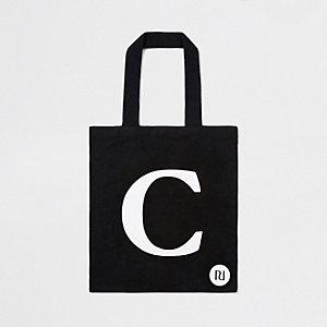 Zwarte shoppertas met 'C'-initiaal