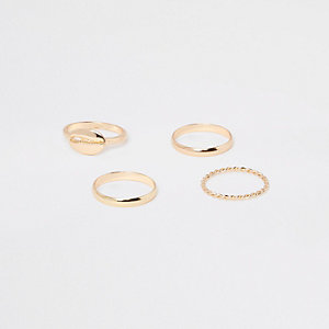 Gold tone cowry ring pack
