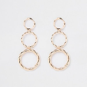 Gold tone triple drop hoop earrings