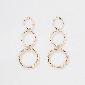 Boucles d'oreilles dorées à trois anneaux tombants