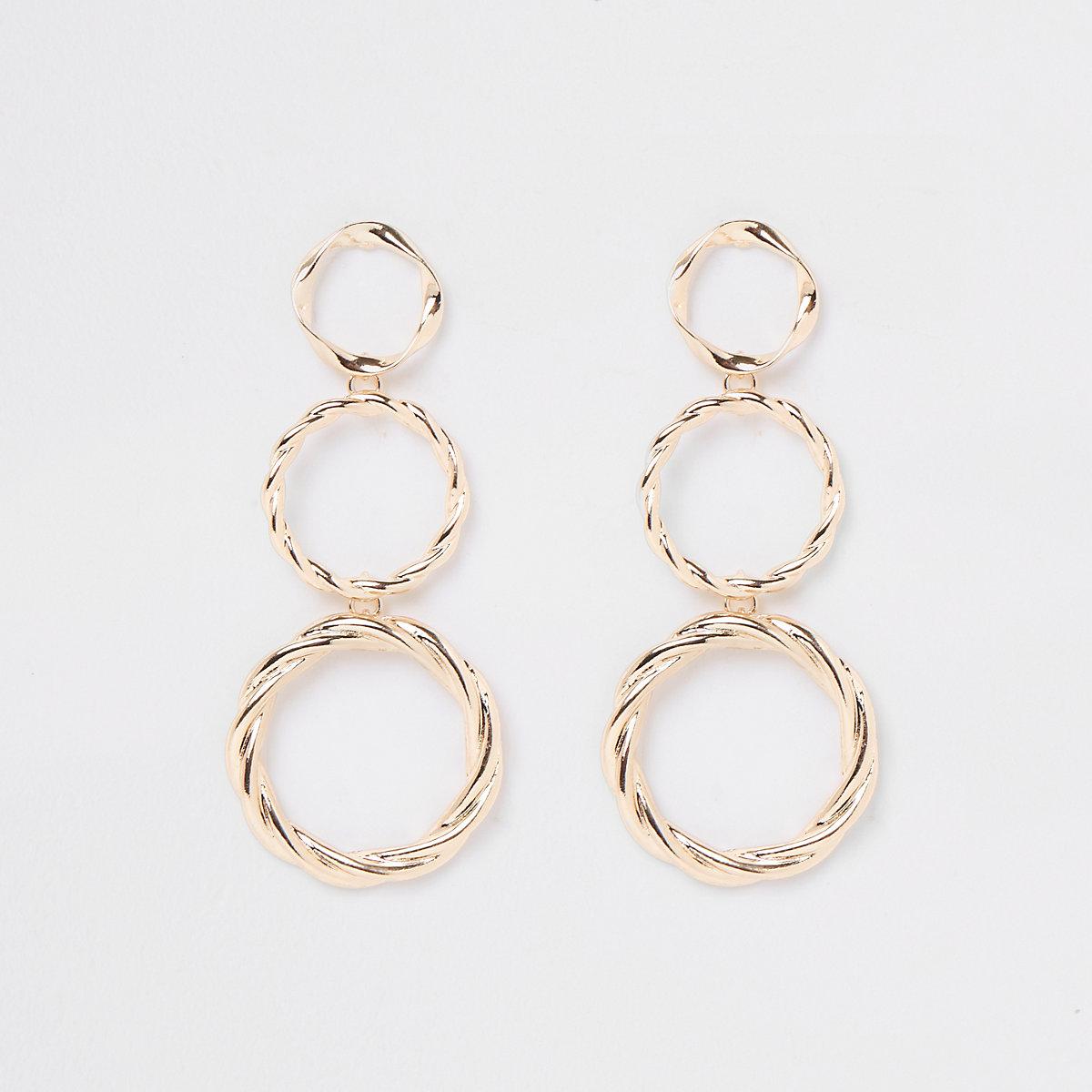 Gold tone triple drop hoop earrings
