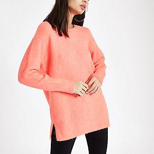 Bright orange knit crew neck sweater