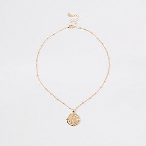 Gold tone medallion pendant necklace