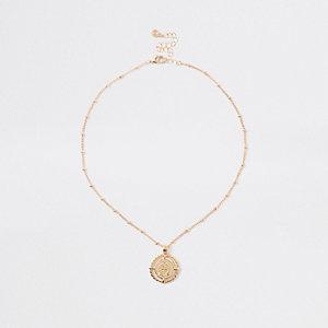 Gold tone medallion pendant necklace