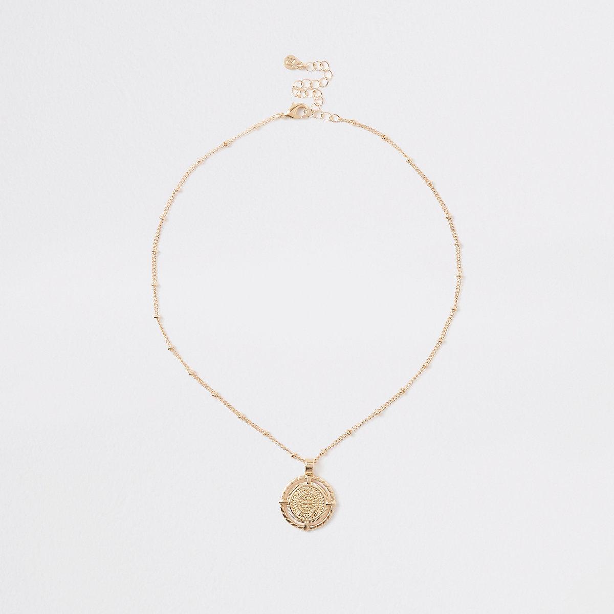 Gold color medallion pendant necklace