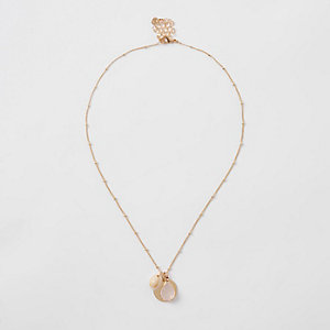 Gold tone cowry shell cluster necklace
