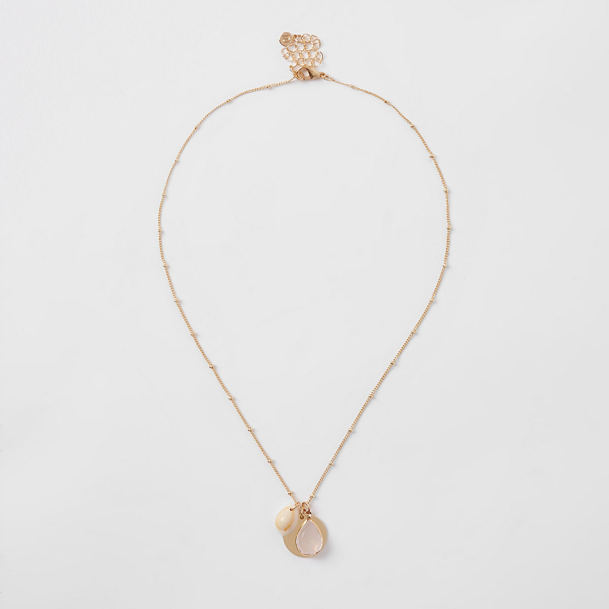 Gold color cowry shell cluster necklace
