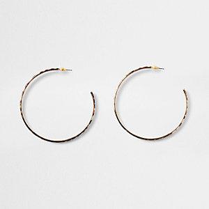 Gold color leopard print hoop earrings