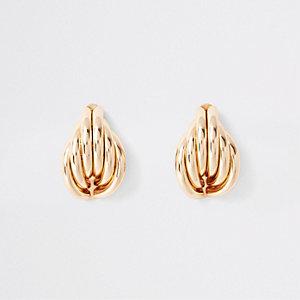 Clous d'oreilles dorés à coquillage replié