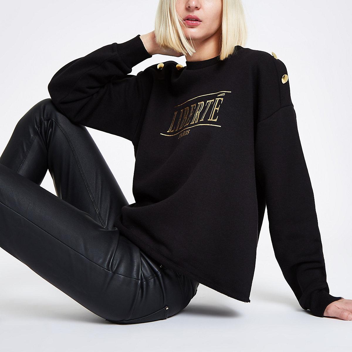 Zwart sweatshirt met 'Liberte'-print en knopen op de schouder
