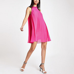 Bright pink pleated halter neck swing dress