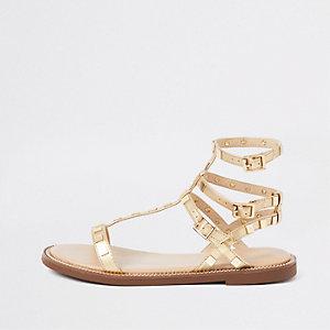 Gold studded gladiator sandals