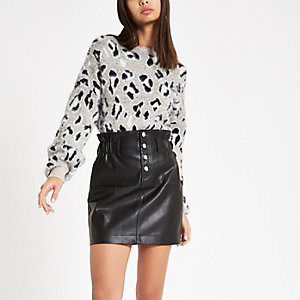 Black faux leather button front mini skirt
