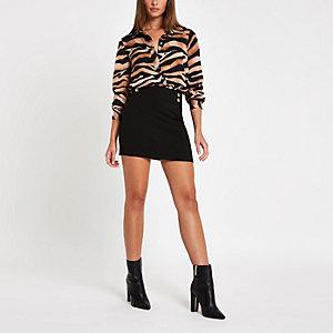 Mini-jupe noire boutonnée