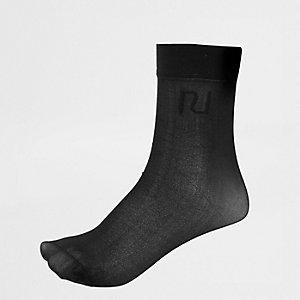 Chaussettes noires transparentes avec logo RI