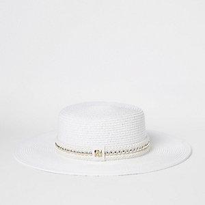 Chapeau en paille tressée blanche orné de perles dorées