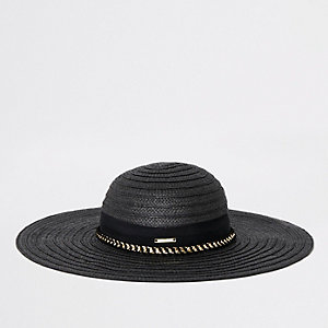 Black oversized floppy straw hat