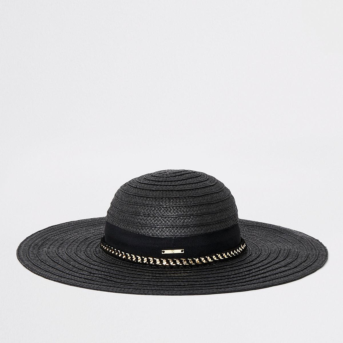 Black oversized floppy straw hat
