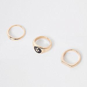 Goudkleurige ringen met glazuur