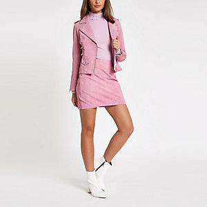 Jupe en daim rose clair zippée sur le côté