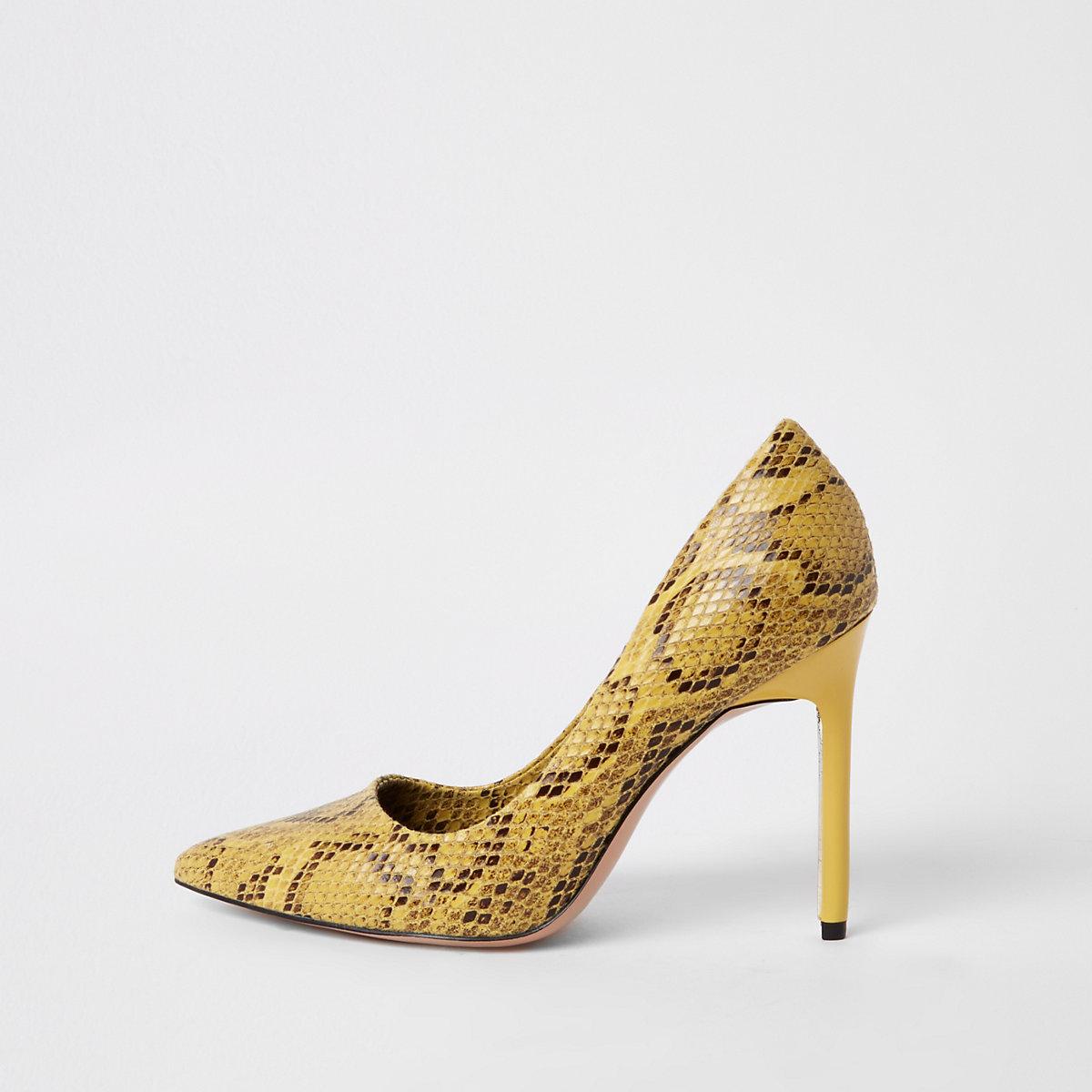 Yellow snake print pumps