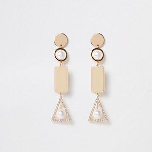 Pendants d'oreilles effet cage dorés à perles