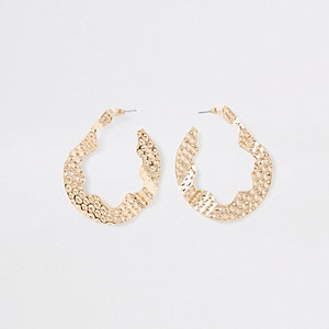 Gold tone battered hoop earrings