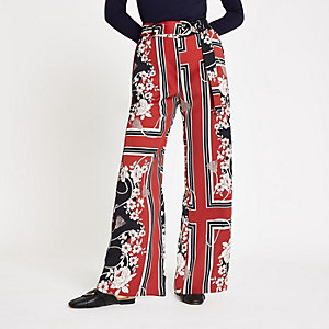 Red floral D-ring belted wide leg trousers