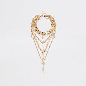 Bracelet de cheville doré à maillons ronds et breloques pièces
