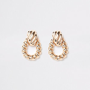 Gold tone large twist doorknocker earrings