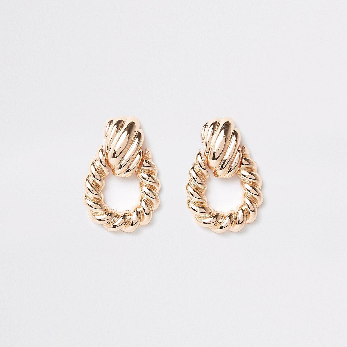 Gold colour large twist doorknocker earrings