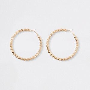 Gold tone bobble rope hoop earrings