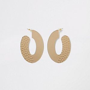 Gold tone hammered large oval hoop earrings