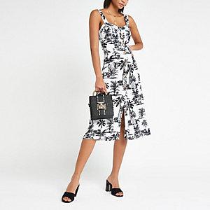 Marineblauwe midi-jurk met print en knopen voor