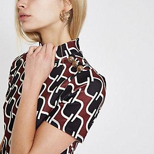Rood T-shirt met geometrische print en knoopjes