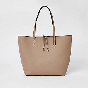 Beige winged tote bag
