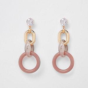 Roze oorhangers met diamantjes