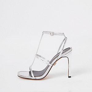 Zilverkleurige sandalen met bandje en hak